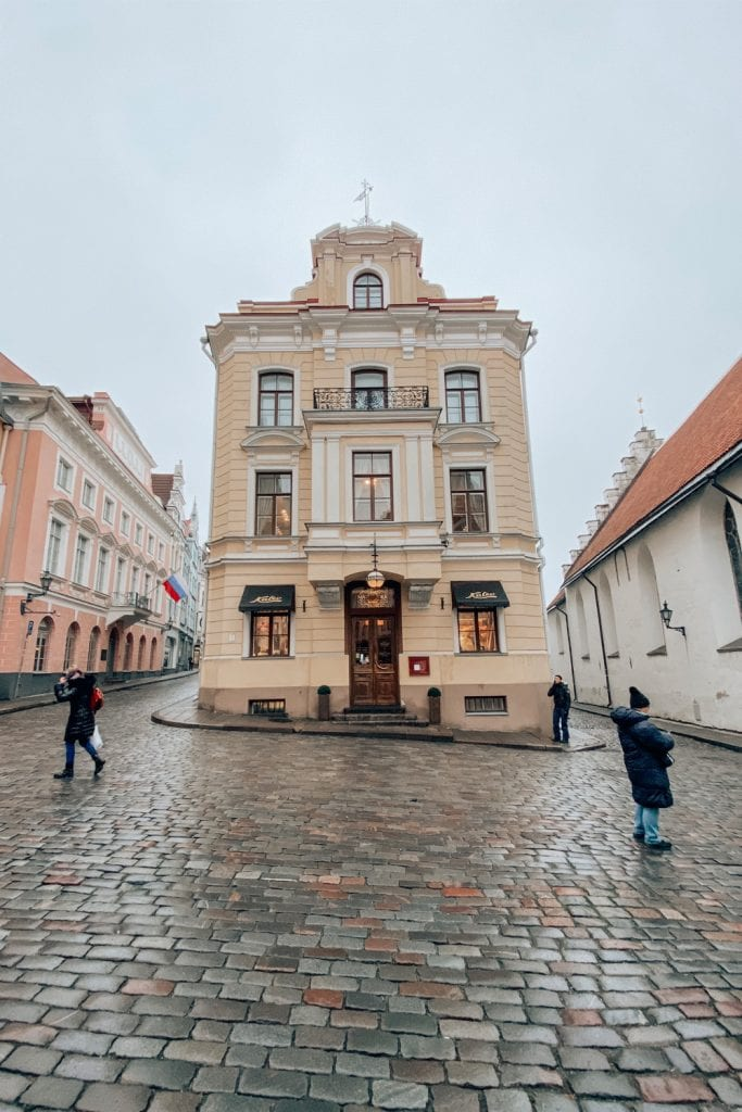 photo of yellow building in old town estonia
