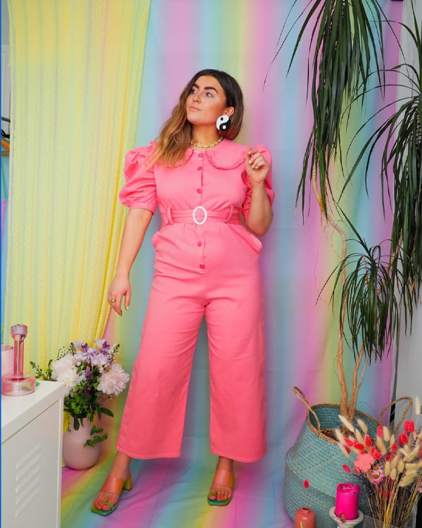 Megan in her pink cari jumpsuit which she has designed