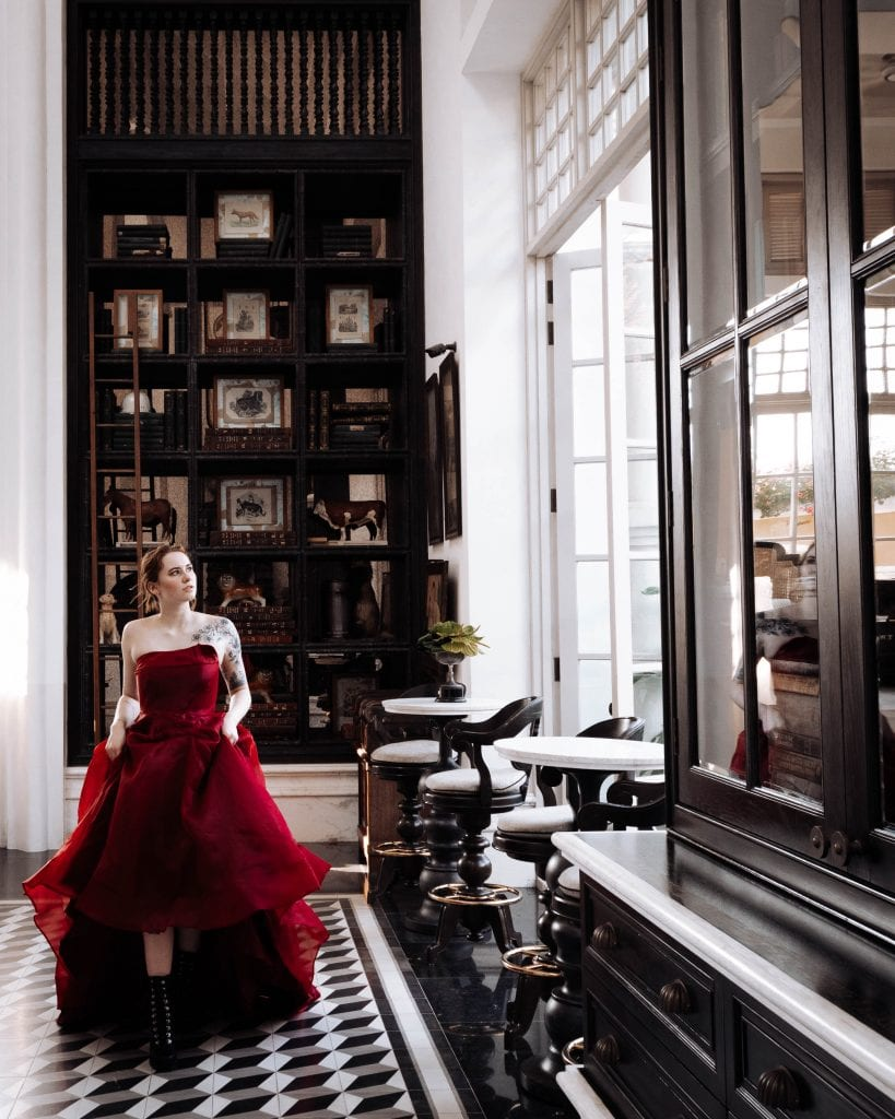 Girl in a red dress in the libary