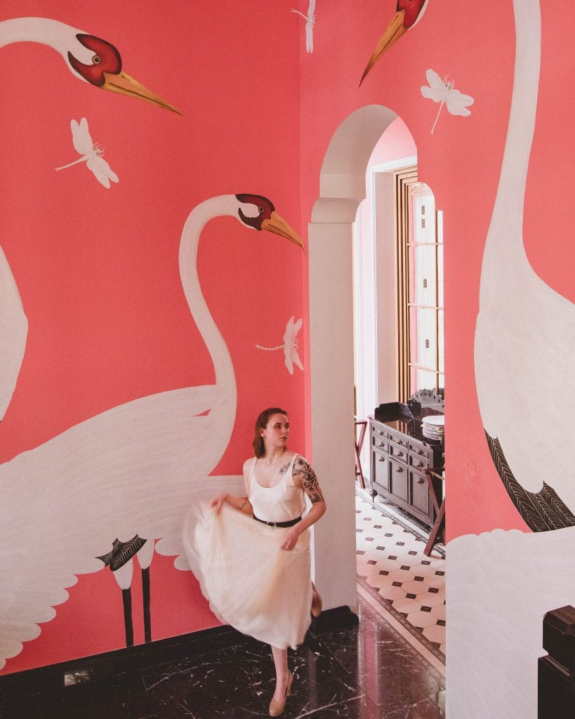 girl by a pink wall
