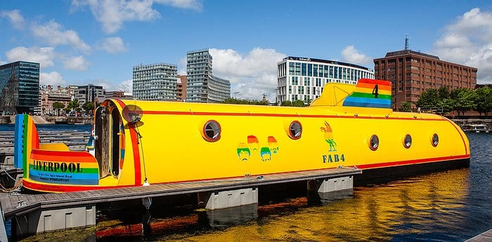 A canal barge made to look like the yellow submarine from the Beatles.