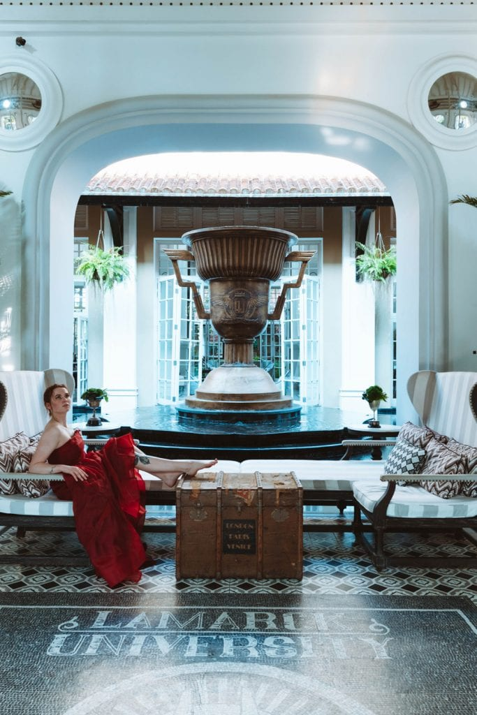 girl in a red dress in a hotel lobby
